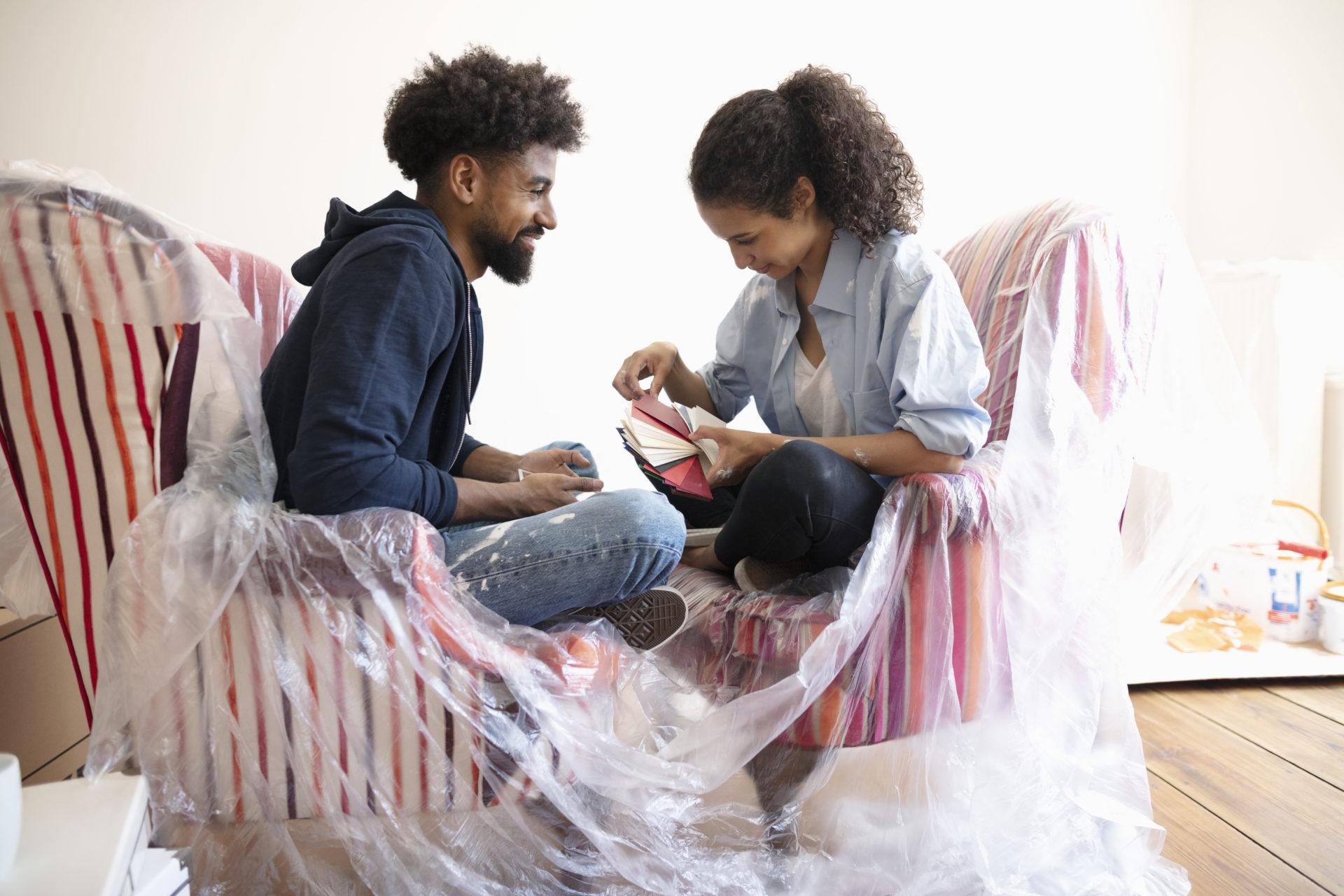 Young couple looking at paint swatches.