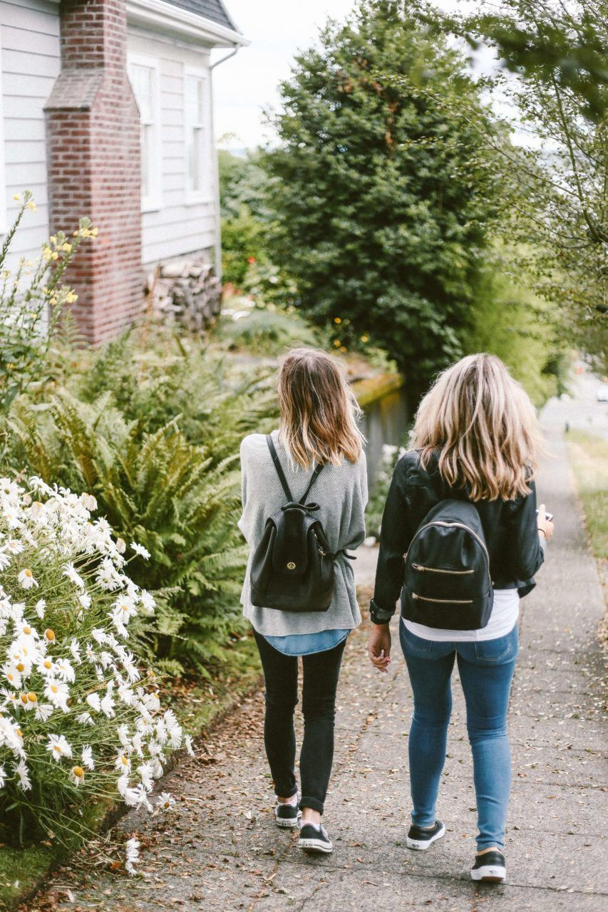Young women walking with backpacks