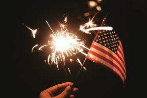 Fourth of July sparkler and flag