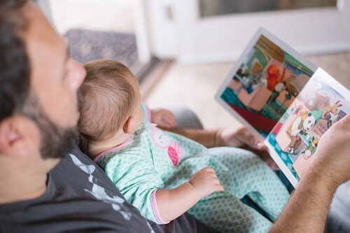 Father reading to baby
