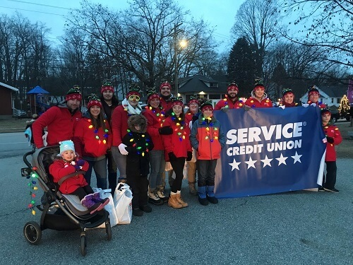 Service Credit Union staff members walking in Laconia parade