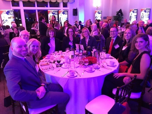 Service CU staff sitting at dinner table at gala