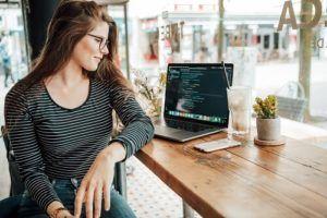 Woman looking at spreadsheet on laptop