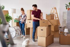 Man and woman unloading boxes in their new apartment
