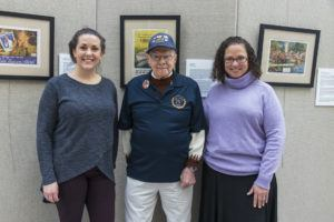 Service CU staff members Jaime Yates and Aimee Sundstrom with World War II Veteran Ray Goulet