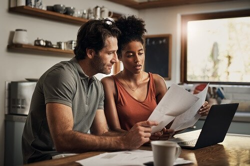 Couple reviewing papers