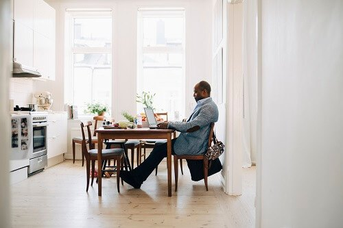 Man working from home at his kitchen table