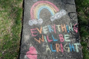 Everything Will Be Alright sign on sidewalk