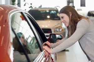 Woman shopping for car at dealership