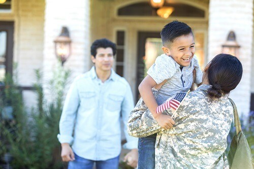 Female Soldier Greeting Family