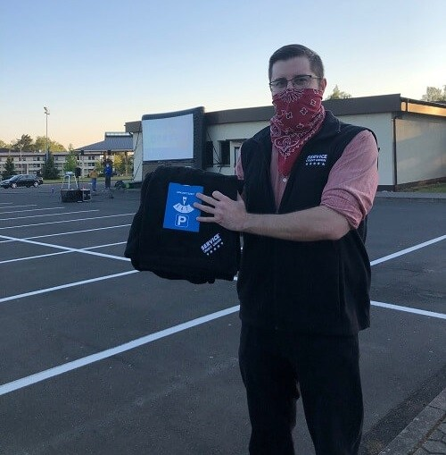 Service CU employyee,, Joshua Lockridge, provides blankets to movie-goers