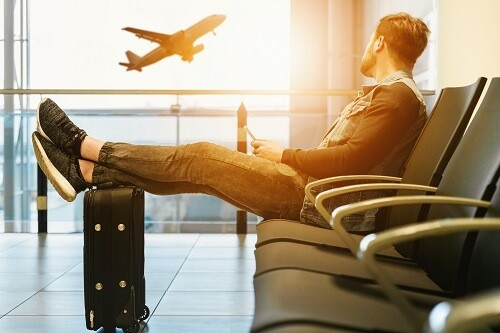 Man waiting for flight in airport