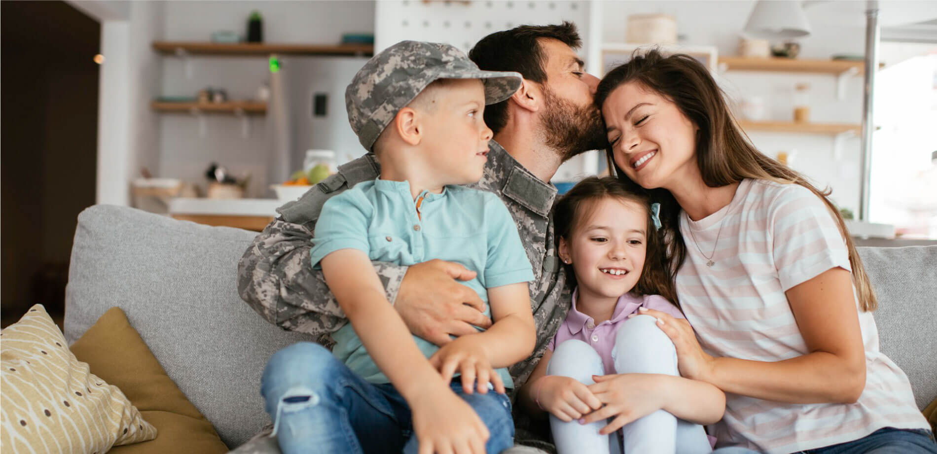 Military family sitting on couch