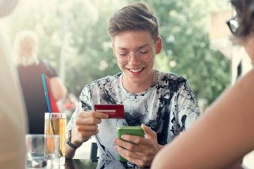 Teenage Boy With Credit Card