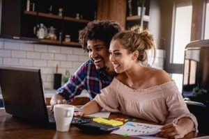 Couple looking at laptop smiling