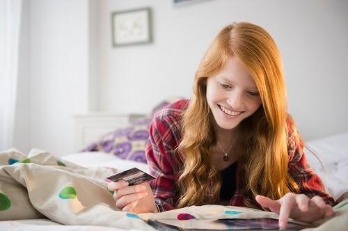 Teenage girl with credit card